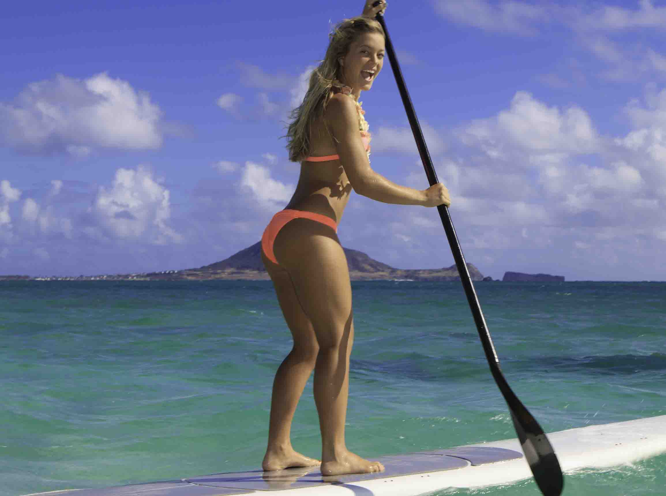 http://www.dreamstime.com/stock-images-girl-bikini-her-paddle-board-image25724614